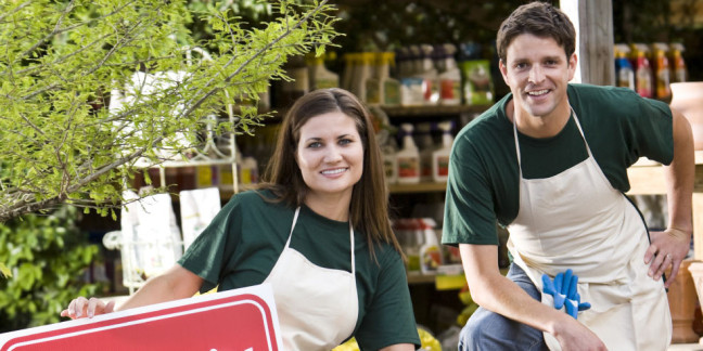 Workers in retail garden store open for business
